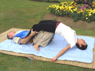 Thai massage version of the yoga bridge position